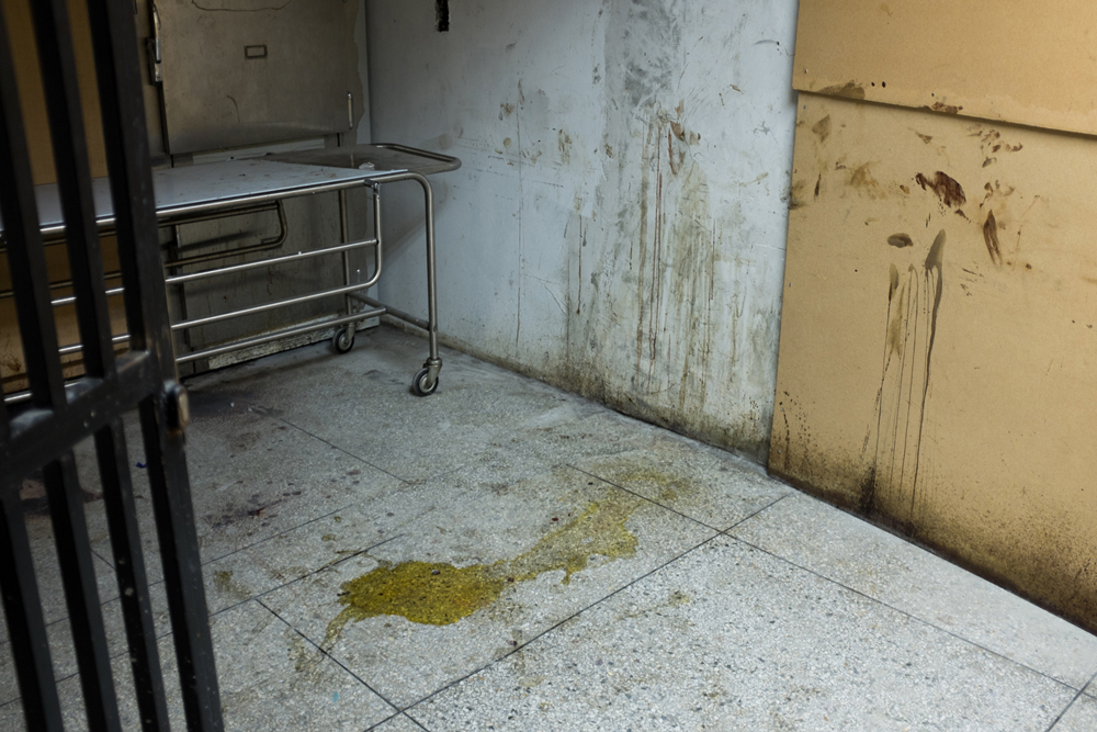 From the series X-Ray. A puddle of urine features in a morgue in a public hospital in Caracas, 1 of the 41 morgues which exist in the whole of Venezuela.©Betty Zapata