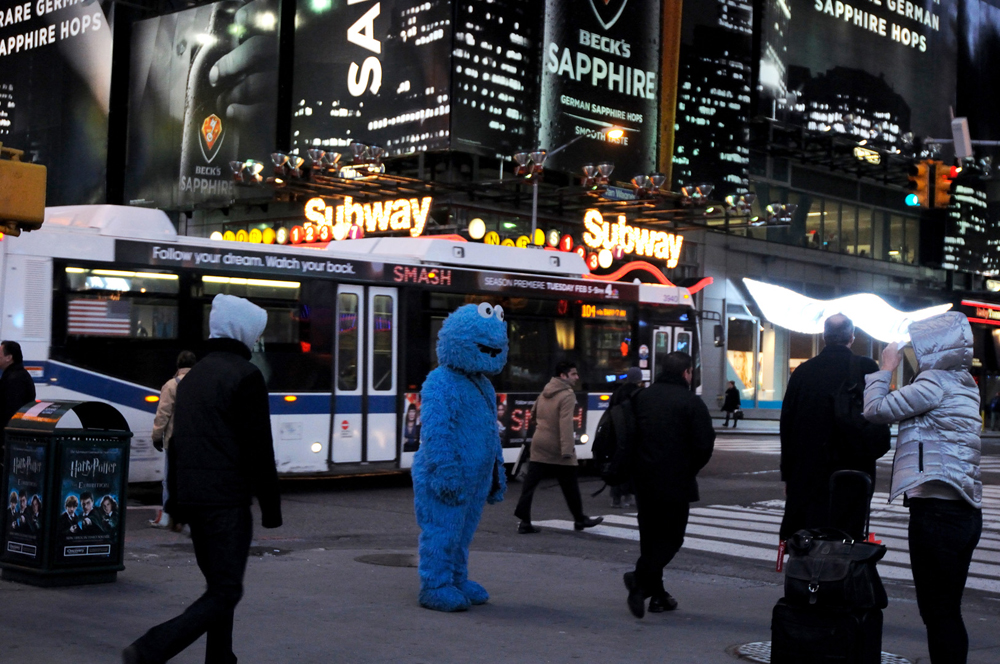New York, United States. Immigrant dressed up as Cokie Monster ask for donations after posing for pictures in Times Square. 2013 ©Joana Toro.