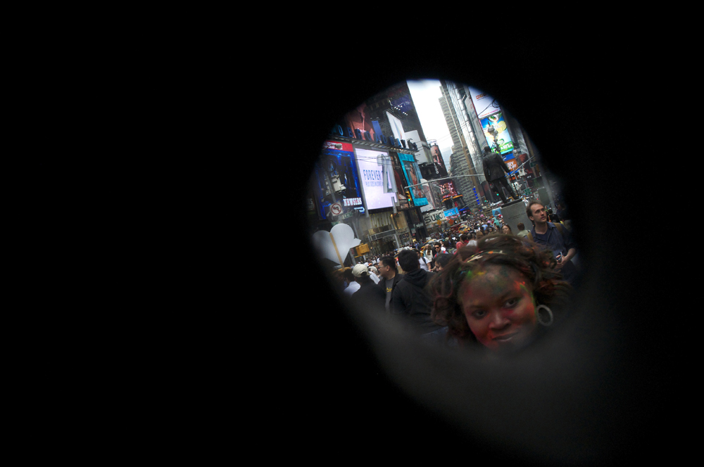 New York, United States. General view right through an eye hole in the head of my Hello Kitty costume. Immigrants dressed up as entertainment symbols ask for donations after posing for pictures in Times Square. 2013 ©Joana Toro.