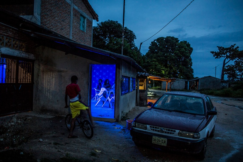 "Jose Maria Morelos, Oaxaca, August 22nd, 2014. A bar in  a late afternoon with rain in Santa Maria Xicometepec, also known as La Boquilla, where the great majority of residents are Afromexicans. For years Mexico's black communities have lived isolated and often forgotten, but still practicing some of the traditions of their African descendants, largely slaves and escaped slaves who fled into remote hills in southern Mexico. But a new effort is underway to officially count the population in the next national census in February, what advocates call a key step in bringing recognition to the communities and making the country more aware of people from what is commonly called ""the third root."" (after European and indigenous roots). Photograph by © Adriana Zehbrauskas"