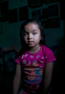 Yeilin, granddaughter and descendant of Octavio Lopez the craftsman, chronicler and village leader. From the series, The Mystery of the Disguised. ©Koral Carballo