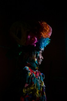 Genaro López Zaragoza, posing in the traditional black Carnival costume. Genaro has danced in the Comparsa for 20 years. From the series, The Mystery of the Disguised. ©Koral Carballo